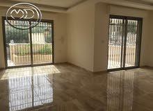 شقة شبه ارضي جديده للبيع في تلاع العلي قرب المستشفى 195م مع ترس 20 م .