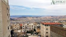 ارض للبيع في وادي صقرة , مساحة الارض 1021م