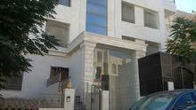 شقة أرضية 203م  الجاردنز مع كراج خاص وحديقة 350 م