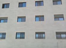 شقة في اسكان للبيع او بدل على قطعة ارض تصلح مزرعة