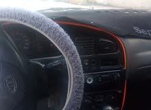 سيارة لون خمري فحص مرفق مع الصور بحاجه ال ترخيص.