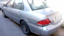 Used condition Mitsubishi Lancer 2005 with +200,000 km mileage