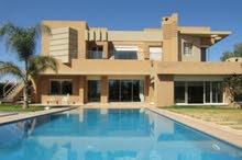 فيلا عصرية مع 2 حمامات سباحة (واحد ساخن) للبيع في مراكش