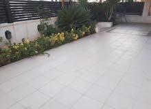 شقه ارضيه مع حديقه للبيع ديرغبار