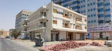 تملك بناية في عجمان شارع الميناء علي دوار الديوان مقابل ديوان الحاكم