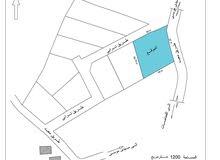 غريان / قطعة أرض للبيع بمحلة تغرنة تطل على شارع معبد مساحتها حوالي 1200 مترمربع
