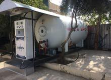 محطة غاز تركياء لبيع تقوم بترس قناني الغاز