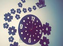 ساعة حائط لون بني غامق