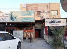 بناية تجارية للبيع بموقع مميز في بغداد