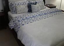 سرير خشبي/a wooden bed