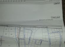 ارض صناعيه 894متر مربع وعلى شارعين تقع بجانب جسر ابو علندا