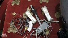 Used Nintendo Wii device with add ons for sale today