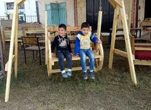 أرجوحة اطفال وأكبر خشبية  جديدة للبيع