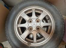 2 Mitsubishi lancer Orginal Rims with almost new tiers 2 weeks used