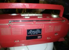 راديو ياباني مسجل كاسيت احمرمع سماعه داخلية و مسجل اصفر بانا سونيك وجهاز تلفزيون