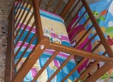 سرير نوم اطفال خشبي