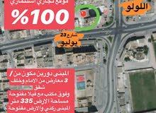 مبنى تجاري للبيع بصلالة أول صفة شارع 23 يوليو على ارض ركنية ومواقف