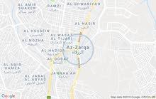 أرض سكنيه الزرقاء حي الاحمدي0795321586