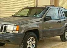For sale 1997 Silver Grand Cherokee