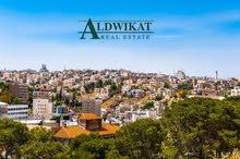ارض مميزة للبيع في اجمل مناطق الشميساني مساحة الارض 881 م