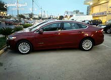 Automatic Maroon Ford 2014 for rent