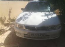 White Mitsubishi Lancer 1999 for sale