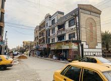 عمارة تجارية ركن للبيع حديثة في الغدير مقابيل شقق زيونة