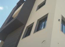 مبنى استثماري في الحشان 4 شقق ومحل . للبيع