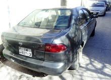 سيارة نيسان صني موديل 1995 لون فيراني بحالة جيدة للبيع أو للبدل