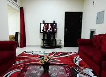 للايجار بعجمان غرفه وصاله مفروش بالروضه قريب من فندق ايوان 3000 شامل مع انترنت