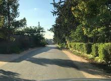 قطعة أرض في عين زارة خلف حوازة الورد مساحة 2000 متر واجهة 55*37 متر للبيع