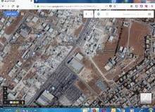 ارض صناعي في الرقيم خلف شركة نقولا ابو خضر للبيع