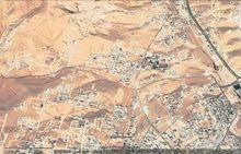 قطعة ارض تجاري في شومر على الطريق الجديد