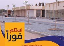مبنى تجارى للبيع بالزاهيه عجمان على شارع جار وقريب من شارع الشيخ محمد بن زايد