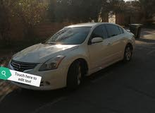 nisan altima car for sale verry good condition personal use car. Arjent for sale living country