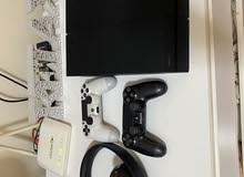 ps4 500 gb with 2 controllers and wireless headsets and games