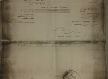 ارض 200 م  للبيع خلف المحافظه جبل طارق