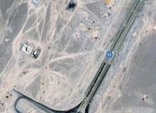 ارض 690م اول خط سكني تجاري خط الرستاق المصنعة