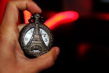 ساعة كوارتز برونزية بغطاء مع سنسال برج ايفل او دراجة جديدة للبيع