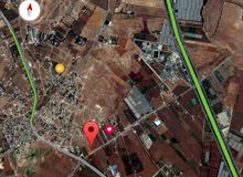 للبيع ارض 2 دونم في ام البساتين خلف جامعه الزيتونه
