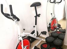 Stationary bike & Dumbbells witj other trining equipment