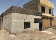 بيت للبيع في منطقة الرستمية ركن عالشارع العام دور الكلية العسكرية الاولى