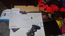 PS2 slim يعمل CD+ معدل فلاشة +كارتونة + فلاشة 16G عليها ألعاب