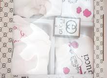 ملابس الماركات لأطفال حديثي الولادة