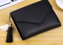 Black wallet price 2BD محفظة سوداء السعر دينارين
