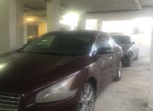 Automatic Maroon Nissan 2010 for sale