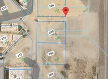 للبيع ارض سكنية زاوية عرضية اول خط رئيسي بالمعبيلة بلوك 11