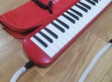 بيانو ميلوديكا نفخ لون ماروني اصلي يوجد توصيل جميع المحافضات