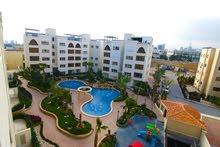 شقة فاخرة ضمن كمباوند فاخر في عمان دير غبار مساحة 180 متر مربع
