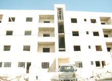 شقة أرضية مميزة 125م مع ترس 70م و كراج ضاحية الحج حسن مع امكانية التقسيط بدون فوائد